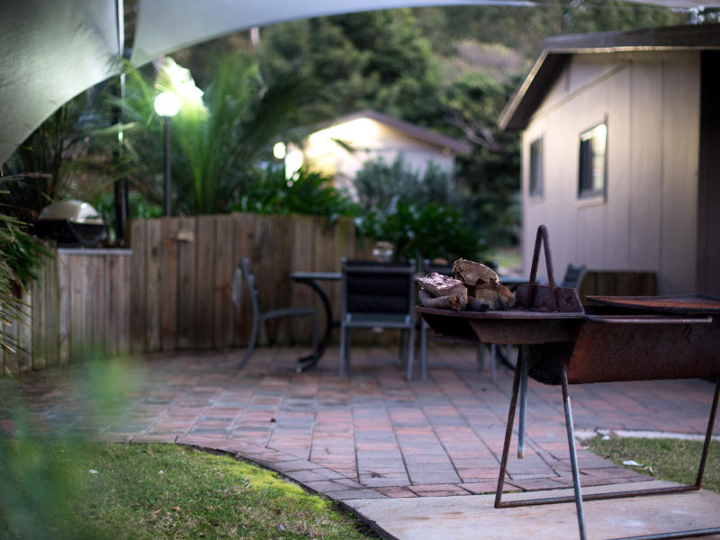 dolphin-cottage Covered BBQ area and firepit